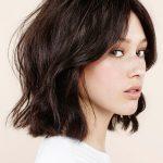 Schwarze Frisuren für kurze Haare wachsen aus
